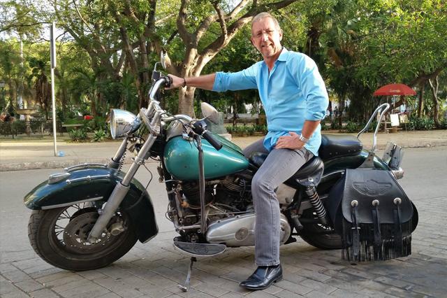 Christopher on Ernesto (son of Che) Guevara's 1948 Harley-Davidson in Havana, Cuba.